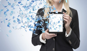 businesswoman holding touch pad with social media icon